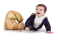 Cute little boy with a toy hare Royalty Free Stock Photography