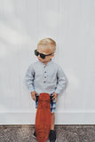 Cute little boy in a trendy summer outfit Royalty Free Stock Image