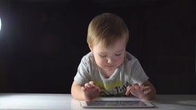Cute Little Boy Uses Digital Tablet.  stock footage