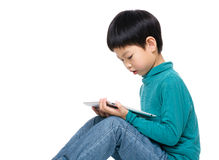 Cute little boy using tablet computer Royalty Free Stock Photos