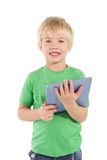 Cute little boy using tablet pc Stock Image