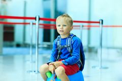 Cute little boy waiting in the airport Stock Images