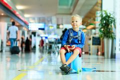Cute little boy waiting in the airport. Child travel Royalty Free Stock Photo