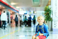 Cute little boy waiting in the airport Royalty Free Stock Images
