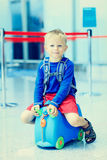 Cute little boy waiting in the airport Stock Image