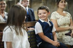 Cute little boy waiting for the bride to arrive stock images