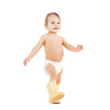 Cute little boy walking in big rubber boots Stock Photo