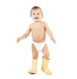 Cute little boy walking in big rubber boots Royalty Free Stock Photography