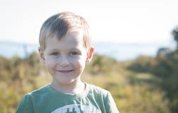 Cute little boy walking outdoors Royalty Free Stock Image