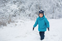 Cute Little Boy Walks In A Snow In The Winter Park Royalty Free Stock Images