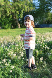 Cute little boy walks in summer. Time Royalty Free Stock Images