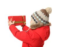 Cute little boy in warm clothes with giftbox Royalty Free Stock Photo