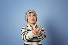 Cute little boy in warm clothes playing with snow Royalty Free Stock Photography