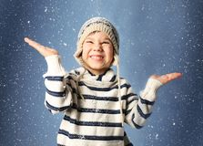 Cute little boy in warm clothes playing with snow Royalty Free Stock Image