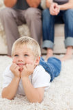 Cute little boy watching television on the floor Royalty Free Stock Photos