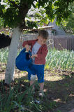 Cute little boy watering the garden Stock Images