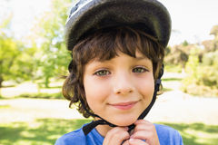 Cute little boy wearing bicycle helmet Stock Images