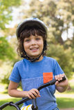 Cute little boy wearing bicycle helmet Royalty Free Stock Photography