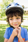 Cute little boy wearing bicycle helmet Stock Photo