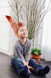 Cute little boy wearing easter bunny ears made of paper sitting royalty free stock images