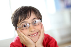 Young boy with glasses and red shirt Stock Photos
