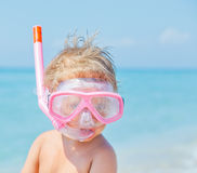 A cute little boy wearing a mask for diving Stock Photo