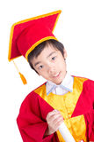Cute Little Boy Wearing Red Gown Kid Graduation With Mortarboard. And Kindergarten Certificate In His Hand Isolated On White Background Royalty Free Stock Photo