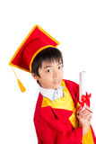 Cute Little Boy Wearing Red Gown Kid Graduation With Mortarboard Royalty Free Stock Photography