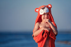 Cute little boy wearing tiger towel outdoors Royalty Free Stock Photo