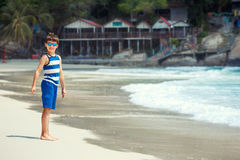 Cute little boy on white sand Thai beach Stock Images