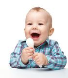 Cute little boy with white spoon Stock Image
