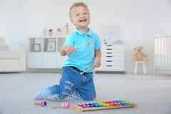 Cute little boy with xylophone. At home Royalty Free Stock Photography