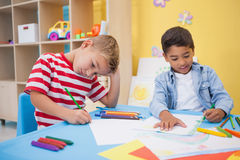 Cute little boys drawing at desk Royalty Free Stock Photography
