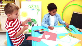 Cute little boys having art time in the classroom stock footage