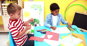 Cute little boys having art time in the classroom stock video