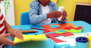 Cute little boys having art time in the classroom stock video footage