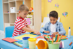 Cute little boys making art in classroom Stock Photos