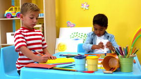 Cute little boys making art together in classroom stock footage