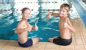 Cute little boys near indoor pool. Cute little boys near indoor swimming pool royalty free stock image