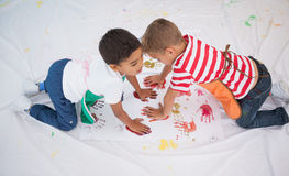 Cute little boys painting on floor in classroom Stock Photography