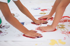 Cute little boys painting on floor in classroom Stock Image
