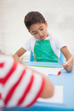 Cute little boys painting at table in classroom Royalty Free Stock Photo