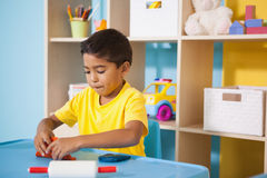Cute little boys playing with modelling clay in classroom Stock Photos