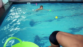 Cute little boys playing in the pool stock footage