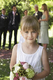 Cute Little Bridesmaid Holding Bouquet In Garden Royalty Free Stock Images