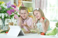 Cute little brother and sister cooking. Together at kitchen Stock Photography