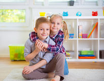 Cute little brother and sister having fun Stock Photo