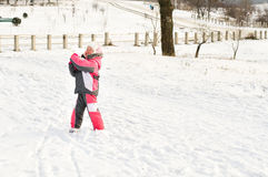 Cute little brother and sister hugging in the snow Stock Image