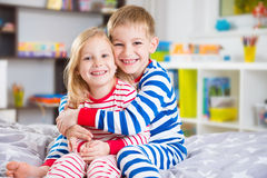 Cute little brother and sister in pajamas Royalty Free Stock Photos