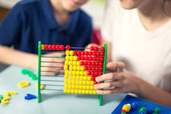 Cute little brother and sister playing with abacus Stock Image